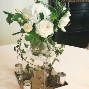 Vases for guest tables containing scented geranium, Hydrangea, Roses and Lisianthus